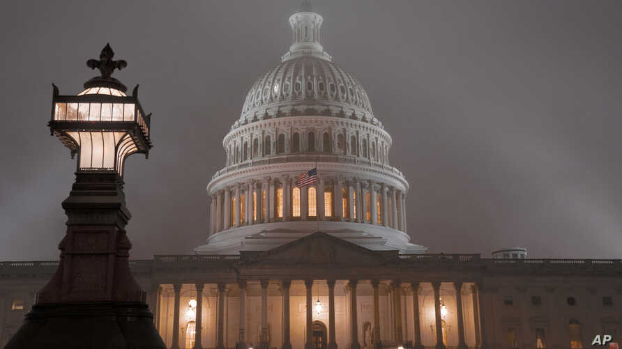 The U.S. Capitol in Washington is shrouded in mist, Friday night, Dec. 13, 2019.  This coming week's virtually certain House…