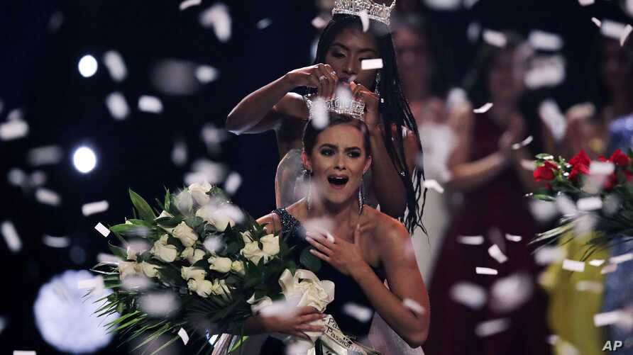 Camille Schrier, of Virginia, reacts as she is crowned after winning the Miss America competition at the Mohegan Sun casino in Uncasville, Conn., Dec. 19, 2019.
