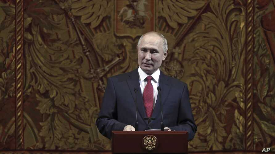 Russian President Vladimir Putin delivers his speech at a gala on the occasion of the New Year at the Bolshoi Theater in Moscow, Russia, Dec. 26, 2019.