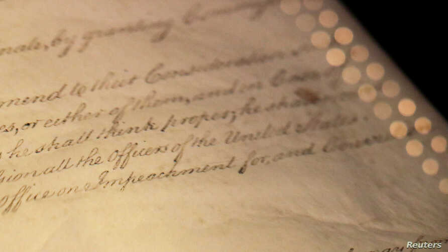 """The word """"Impeachment"""" as it is written in Article II of the U.S. Constitution, is seen on display in the Rotunda for the Charters of Freedom at the National Archives Museum in Washington."""