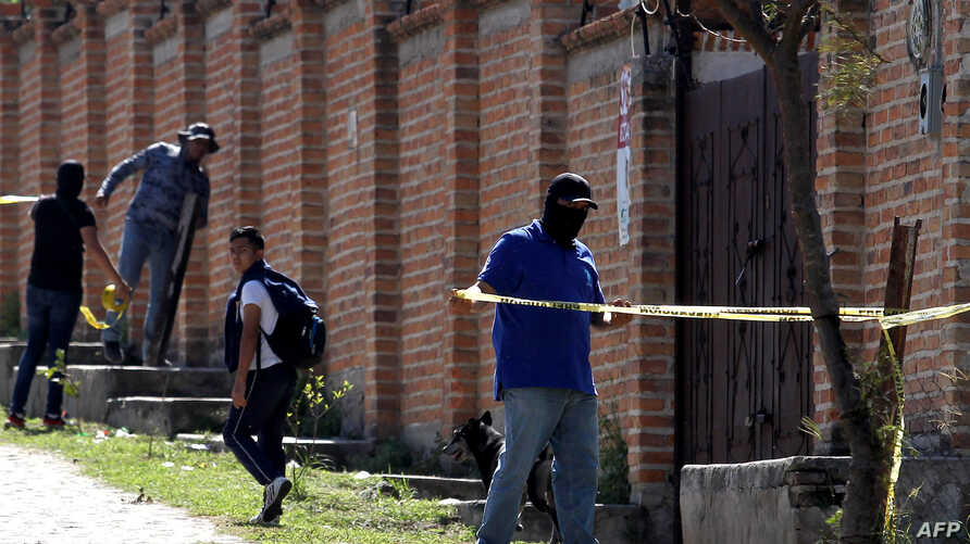 Staff of the Specialized Prosecutor's Office for Missing Persons work at El Mirador neighborhood, in Tlajomulco de Zuniga, state of Jalisco, Mexico, Nov. 22, 2019.