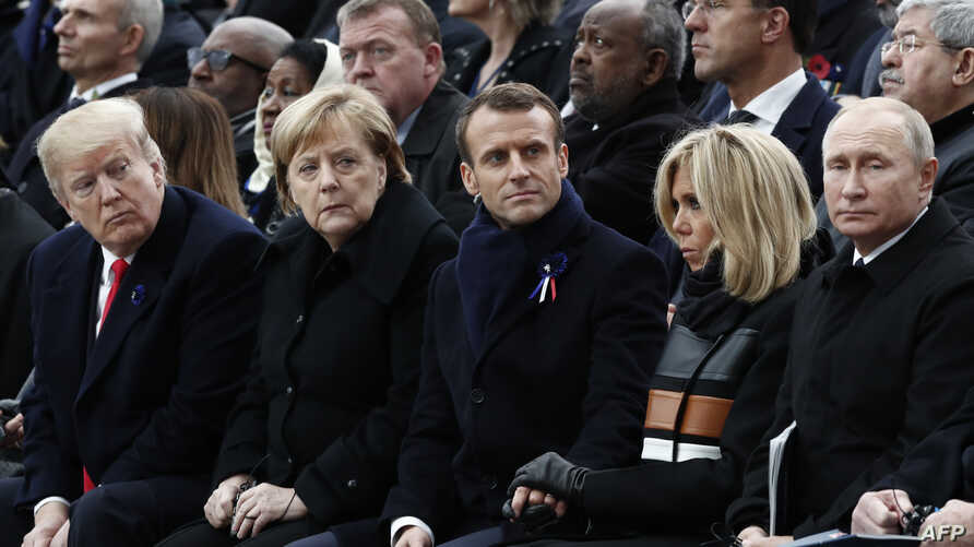 From left, President Donald Trump, German Chancellor Angela Merkel, French President Emmanuel Macron and his wife Brigitte Macron, and Russian President Vladimir Putin attend an Armistice Day ceremony in Paris, France, Nov. 11, 2018.