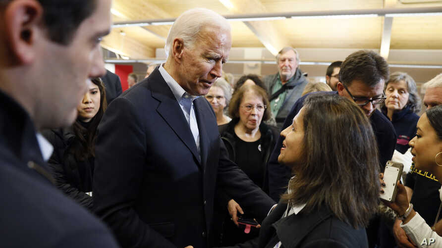 Democratic presidential candidate former Vice President Joe Biden talks with audience members during a bus tour stop at Water's Edge Nature Center, Dec. 2, 2019, in Algona, Iowa.