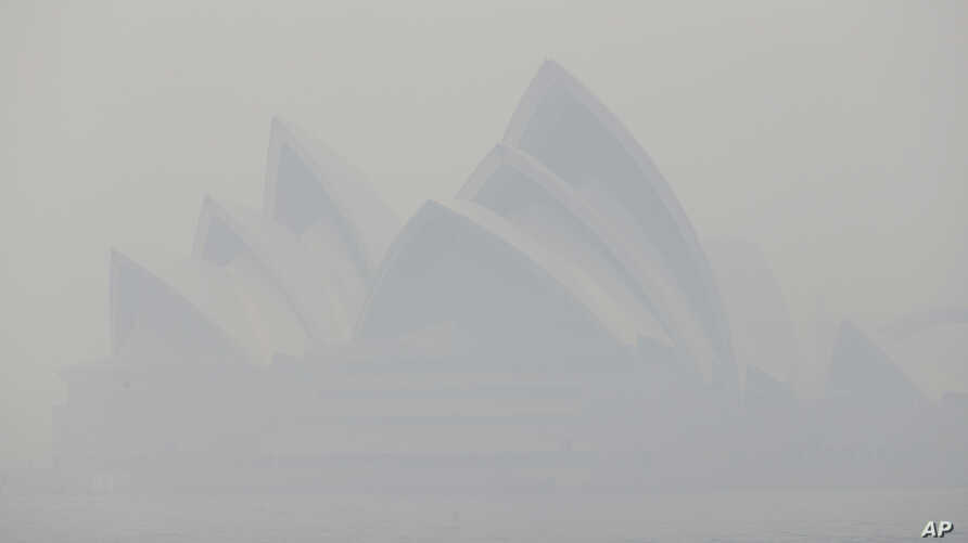 Thick smoke from wildfires shroud the Opera House in Sydney, Australia, Dec. 10, 2019.