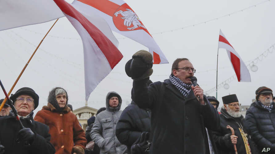 Belarus opposition activist Vyacheslav Sivchik speaks during a protest against the country's closer integration with Russia, which protesters fear could erode the post-Soviet independence of Belarus, in Minsk, Belarus, Dec. 29, 2019.