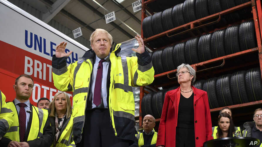 Britain's Prime Minister Boris Johnson talks during a question and answer session, part of a General Election campaign visit to Ferguson's Transport in Washington, England, Dec. 9, 2019.