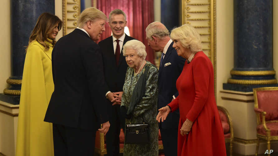 U.S. President Donald Trump and First Lady Melania Trump meet with Queen Elizabeth II, Prince Charles and Camilla, Duchess of Cornwall, during a reception at Buckingham Palace in London, Dec. 3, 2019.