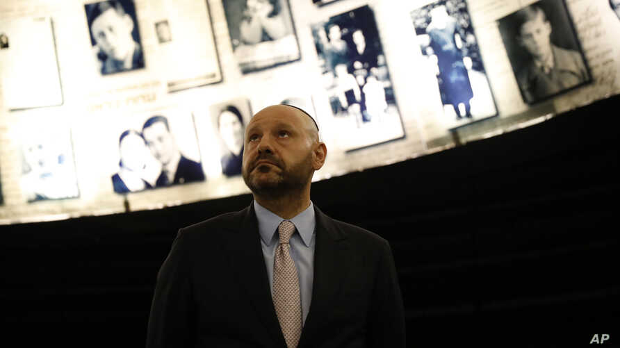Lebanese-born Swiss real estate mogul Abdallah Chatila, who purchased Nazi memorabilia at a German auction and is donating the items to Israel, visits the Hall of Names in Yad Vashem, in Jerusalem, Dec. 8, 2019.