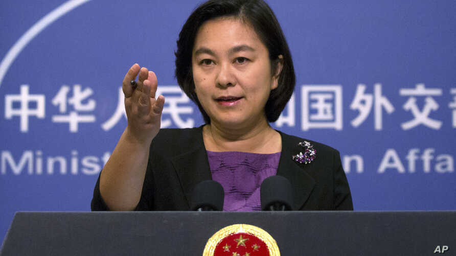 FILE - Chinese Foreign Ministry spokeswoman Hua Chunying speaks during a press briefing at the Ministry of Foreign Affairs building in Beijing, Sept. 15, 2017.