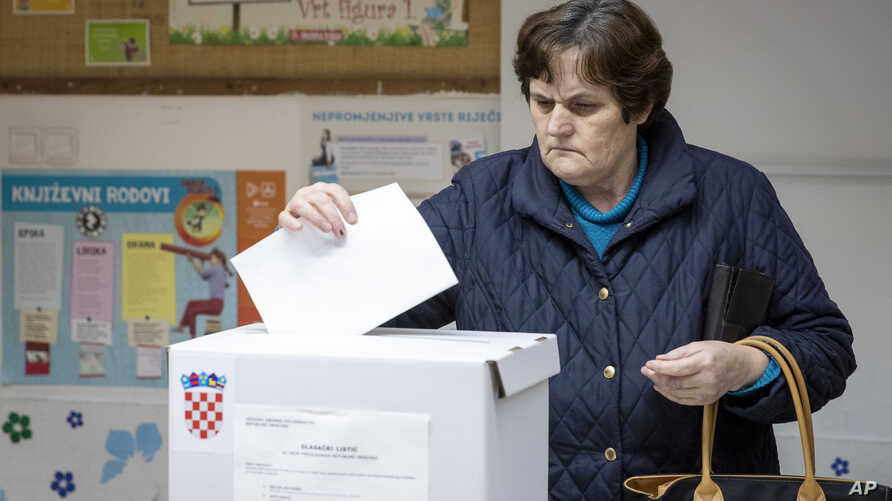 A voter casts her ballot at a polling station in Zagreb, Croatia, Dec. 22, 2019.