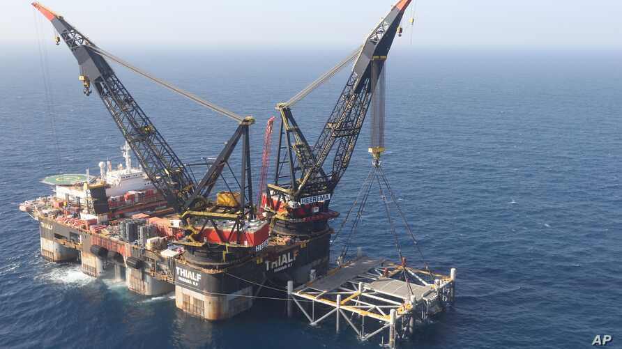 FILE - An oil platform is seen in the Leviathan natural gas field, in the Mediterranean Sea off the Israeli coast. Israel became a major energy exporter Dec. 16, 2019, after signing a permit to export natural gas to neighboring Egypt.