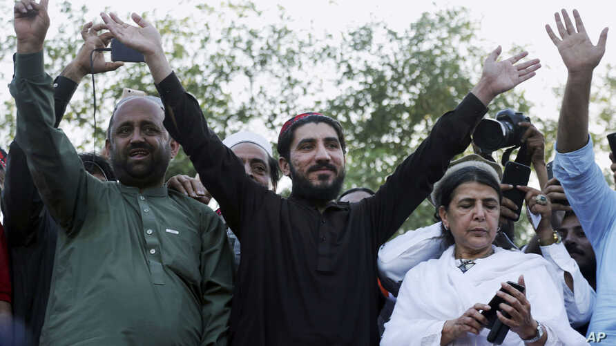 FILE - Manzoor Pashteen, center, leader of Pakistan's Pashtun Tahafuz Movement (PTM), waves to his supporters during a rally in Lahore, Pakistan, April 22, 2018.