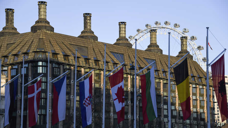 Flags of NATO member countries fly in Parliament Square, ahead of the alliance's summit to be held Dec. 3-4 in London, Britain, Dec. 2, 2019.