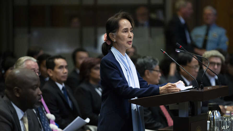 Myanmar's leader Aung San Suu Kyi addresses judges of the International Court of Justice on the second day of three days of hearings in The Hague, Netherlands, Dec. 11, 2019.