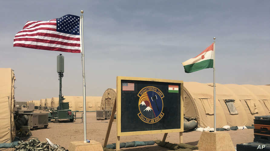 A U.S. and Niger flag are raised side by side at the base camp for air forces and other personnel supporting the construction of Niger Air Base 201 in Agadez, Niger, April 16, 2018.