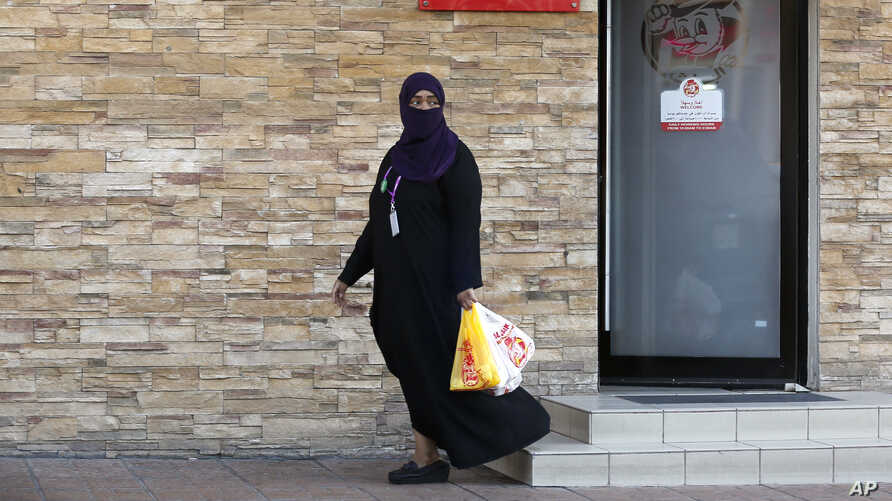 A woman leaves a ladies-only service area at a restaurant in Jiddah, Saudi Arabia, Dec. 8, 2019.