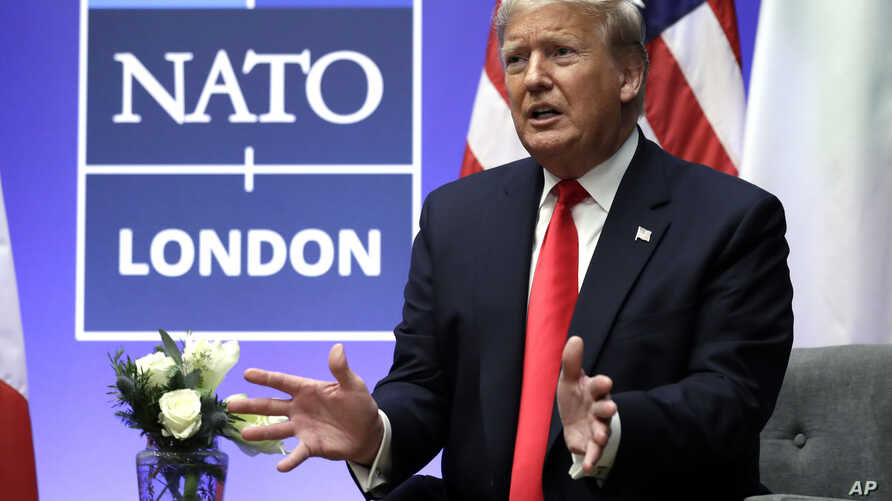 President Donald Trump speaks as he meets with Italian Prime Minister Giuseppe Conte (not pictured) during the NATO summit at The Grove, in Watford, England. Dec. 4, 2019.