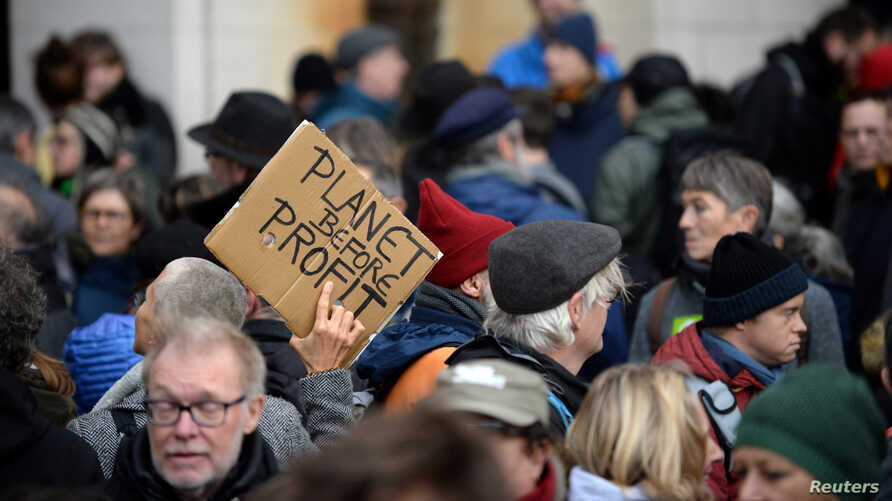 People attend a climate change protest in Brussels, Belgium, Dec. 8, 2019.