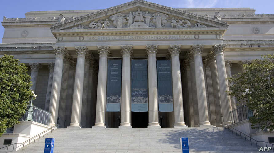 The US National Archives building is shown in Washington, DC, 21 July 2007. The building's main rotunda allows visitors to view…