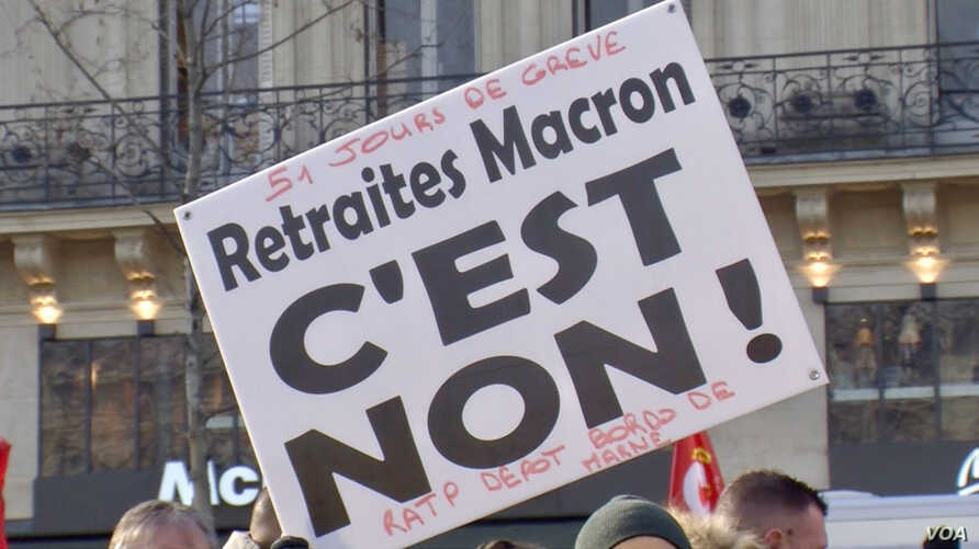 A sign denouncing President Emmanuel Macron's pension reforms notes that the protest movement marked its 51st day, Jan. 24, 2020, in Paris. (Lisa Bryant/VOA)