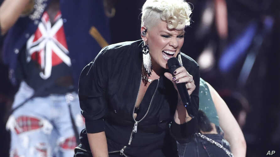 FILE - Pink performs at the 2017 iHeartRadio Music Festival Day 1 held at T-Mobile Arena in Las Vegas, Sept. 22, 2017.