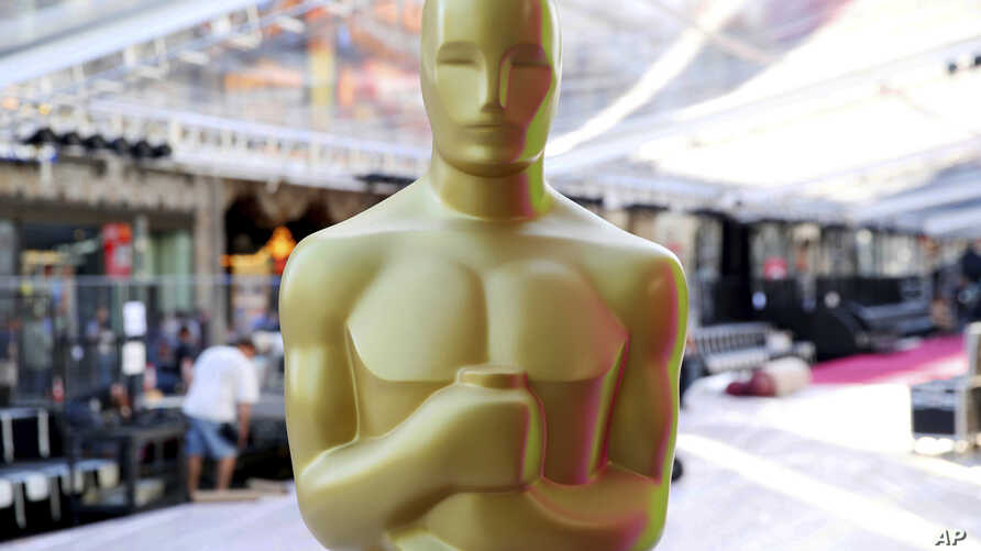 FILE - An Oscar statue is seen during setup for the 88th Academy Awards in Los Angeles, Feb. 24, 2016.