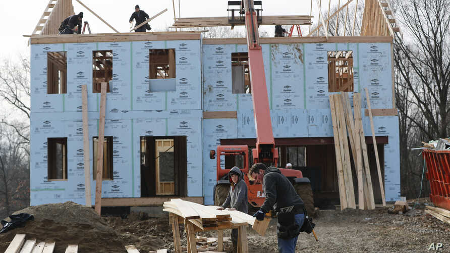 FILE- In this Jan. 4, 2019, file work continues on a plan of new homes in Franklin Park, Pa. On Thursday, March 7, the Labor Department issues revised data on productivity in the fourth quarter. (AP Photo/Keith Srakocic, File)