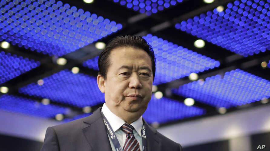 FILE - Interpol President, Meng Hongwei, walks toward the stage to deliver his opening address
