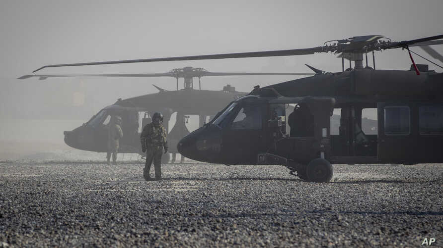 Blackhawk helicopters are parked at a U.S. military base at undisclosed location in Eastern Syria, Monday, Nov. 11, 2019. A…