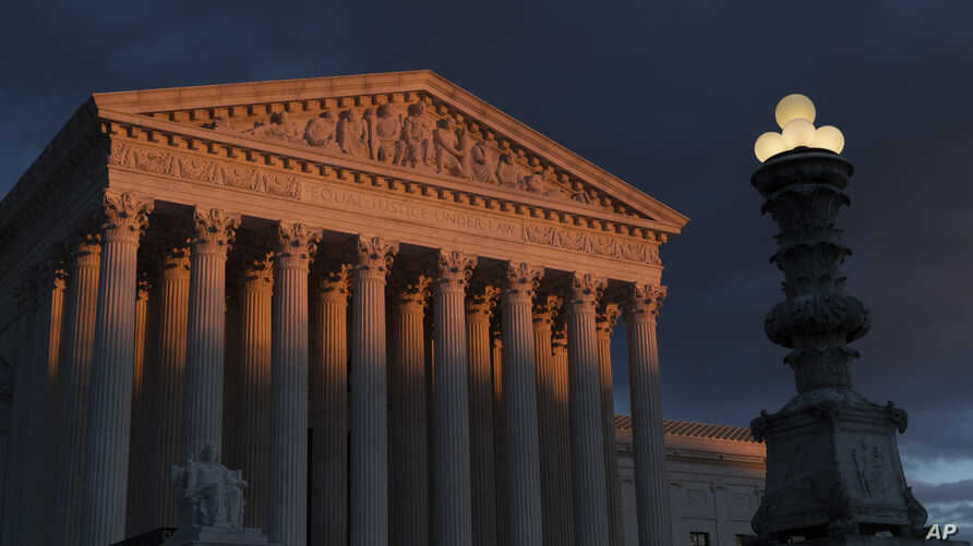FILE - The Supreme Court is seen at sunset in Washington.