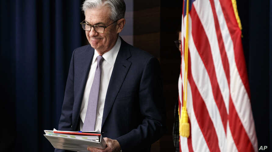 FILE - In this Dec. 11, 2019, file photo Federal Reserve Chair Jerome Powell arrives to speak at a news conference after the…