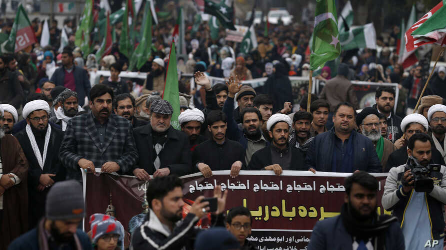 Pakistani Shiite Muslims participate in a rally to condemn the killing of Iranian Revolutionary Guard Gen. Qassem Soleimani by…