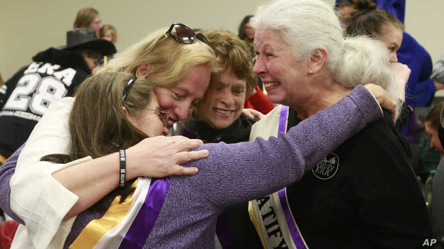 Supporters of the Equal Rights Amendment react to the Senate Privileges and Elections committee vote to report the ERA…