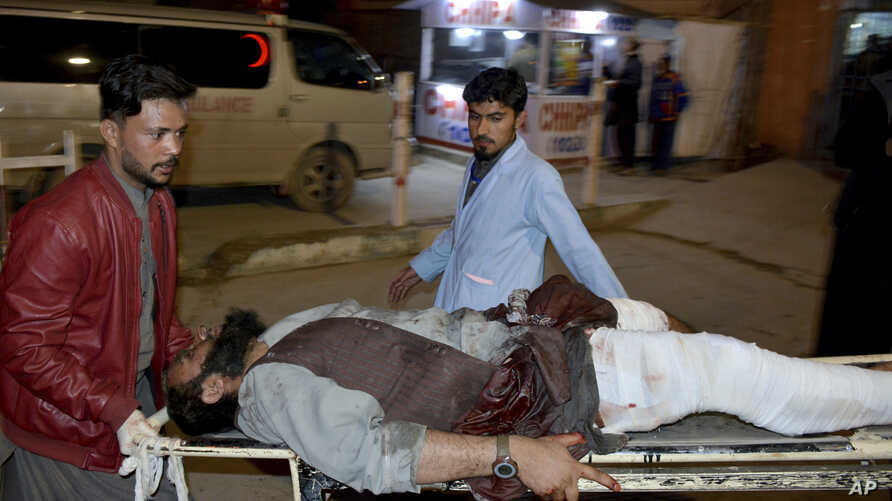 An injured victim of mosque bombing, is brought to hospital in Quetta, Pakistan, Jan. 10, 2020.