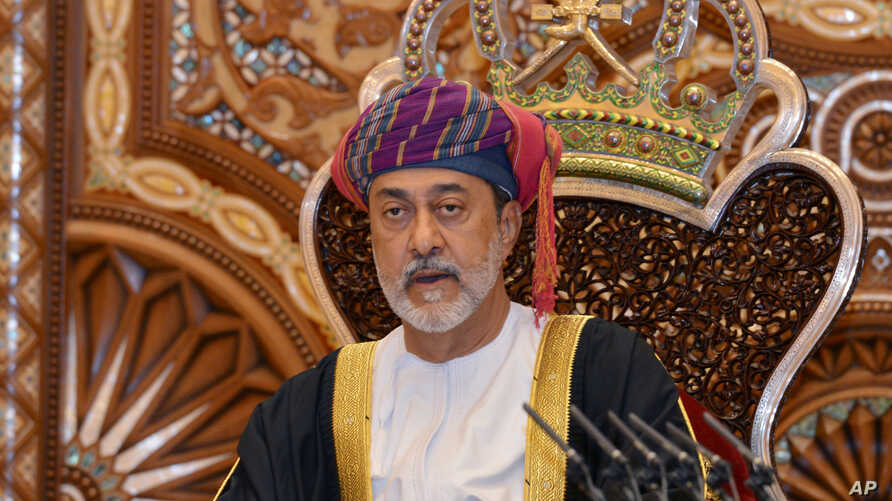 In this photo made available by Oman News Agency, Oman's new sultan Haitham bin Tariq Al Said, makes his first speech after swearing in at the Royal Family Council in Muscat, Oman,vJan. 11, 2020.