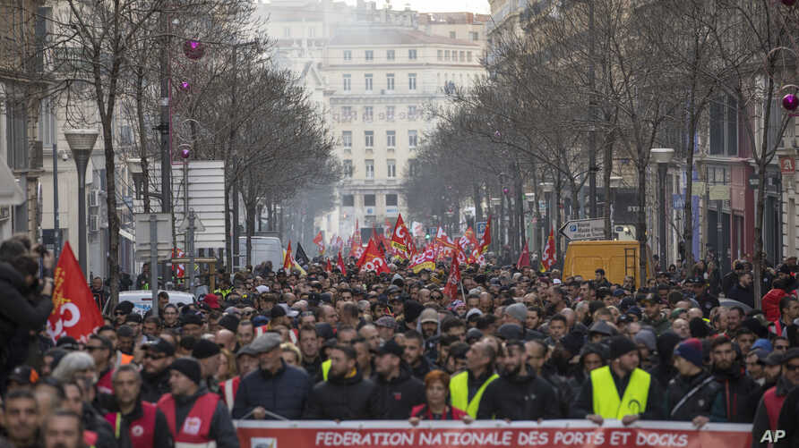 Strikers march during a demonstration in Marseille, southern France, Jan. 14, 2020.