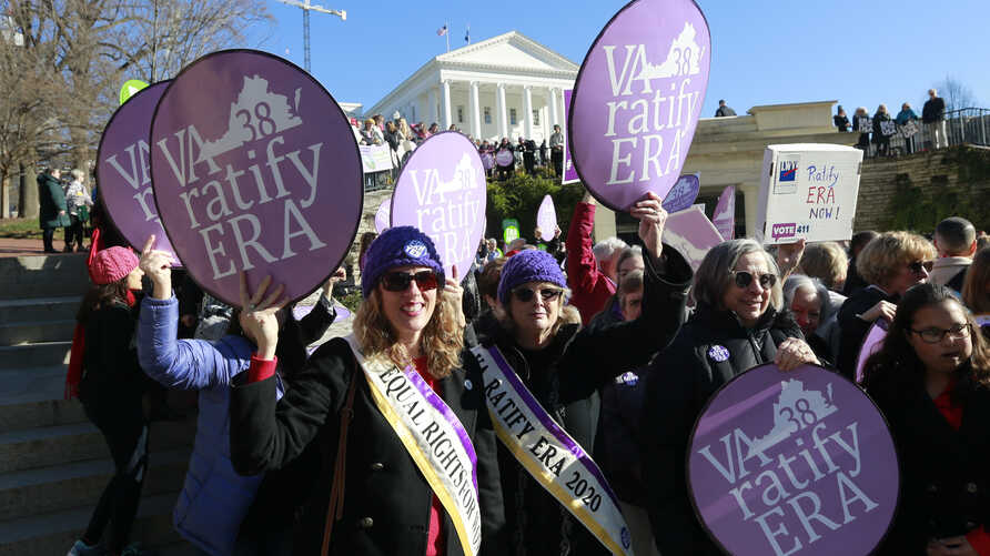 FILE - In this Wednesday, Jan. 8, 2020, file photo, Equal Rights Amendment supporters demonstrate outside Virginia State…