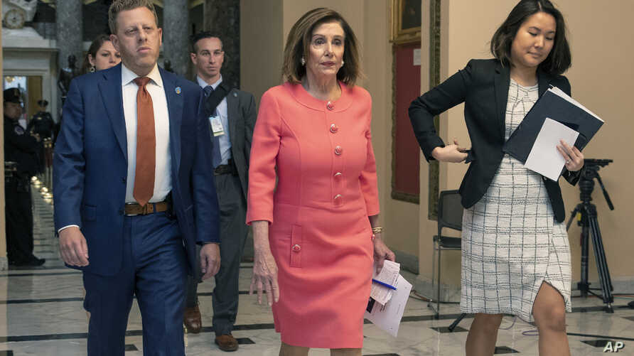 House Speaker Nancy Pelosi of Calif., center, walks towards the House Chamber on Capitol Hill, Jan. 15, 2020.