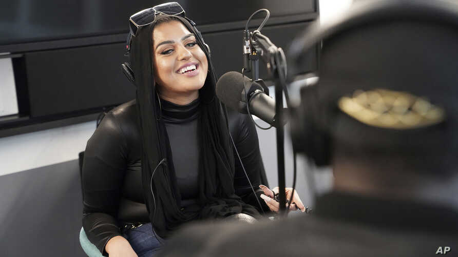 """Amani Al-Khatahtbeh, founder of Muslimgirl.com, records a podcast pilot at Spotify's headquarters in New York, Dec. 19, 2019. On her site, Al-Khatahtbeh is especially proud of stories that deal with race and sexuality. """"Of course, female sexuality is honored within our religion."""