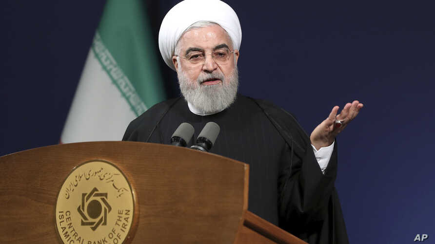 In this photo released by the official website of the office of the Iranian Presidency, President Hassan Rouhani speeches…