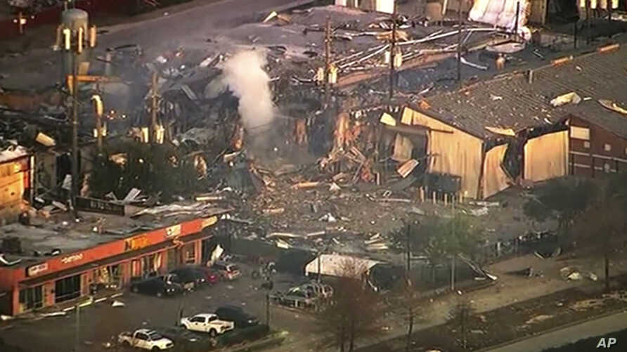 This aerial photo taken from video provided by KTRK-TV shows damage to buildings after an explosion in Houston on Friday.