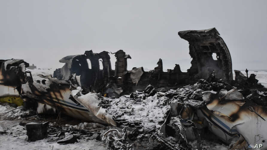 A wreckage of a U.S. military aircraft that crashed in Ghazni province, Afghanistan, is seen Monday, Jan. 27, 2020.