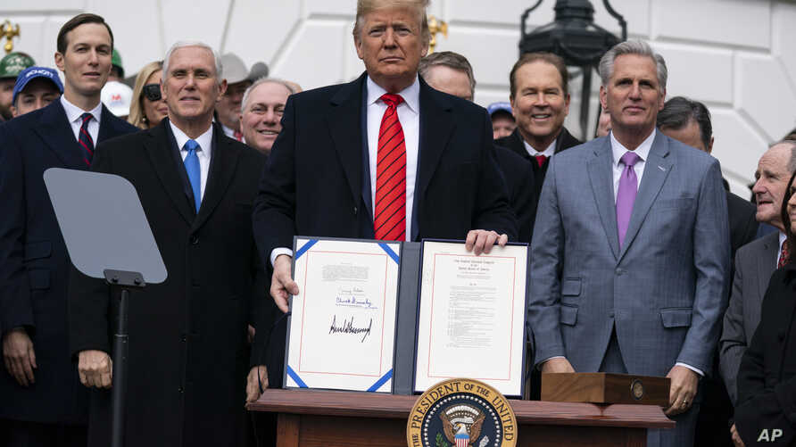 President Donald Trump shows off a new North American trade agreement with Canada and Mexico, during an event at the White…