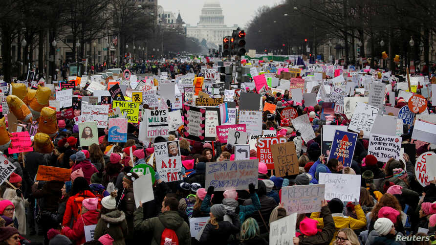 FILE - Thousands of people participate in the Third Annual Women's March at Freedom Plaza in Washington, Jan. 19, 2019.
