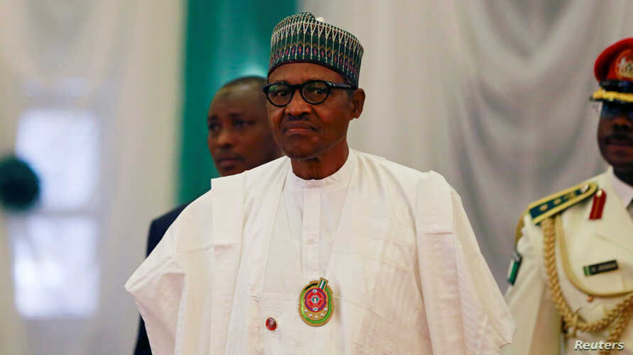 Nigeria's President Muhammadu Buhari attends the opening of the 56th Ordinary Session of the ECOWAS Authority of Heads of State…