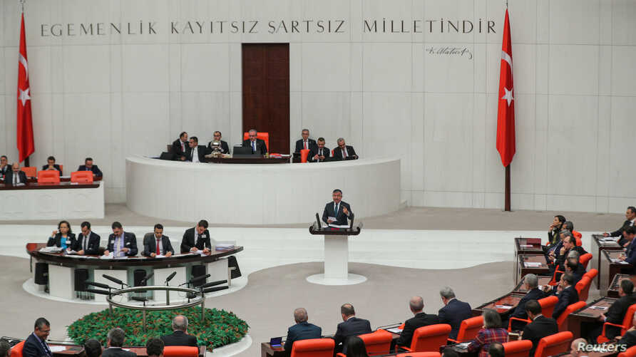 Ismet Yilmaz, head of the parliament's national defence committee from the ruling AK Party, addresses lawmakers at the Turkish…
