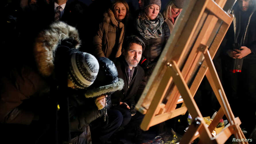 Canada's Prime Minister Justin Trudeau attends a candle light vigil for the victims of Ukraine International Airlines flight PS…