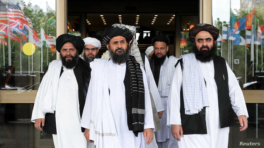 FILE - Taliban delegation leaving after peace talks with Afghan senior politicians in Moscow, Russia May 30, 2019.