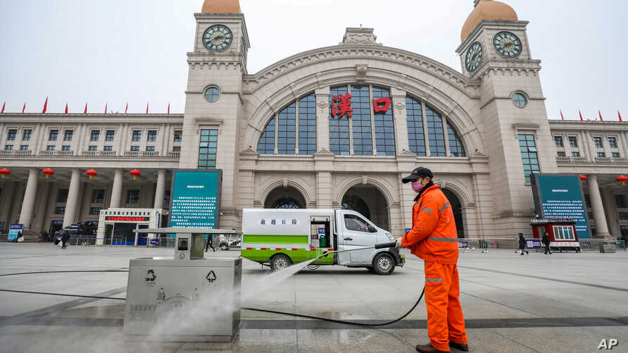 A worker sanitizes the square in front of the Hankou Railway Station, closed after the city of Wuhan was locked down following the outbreak of a new coronavirus, in Wuhan, Hubei province, China Jan. 23, 2020.