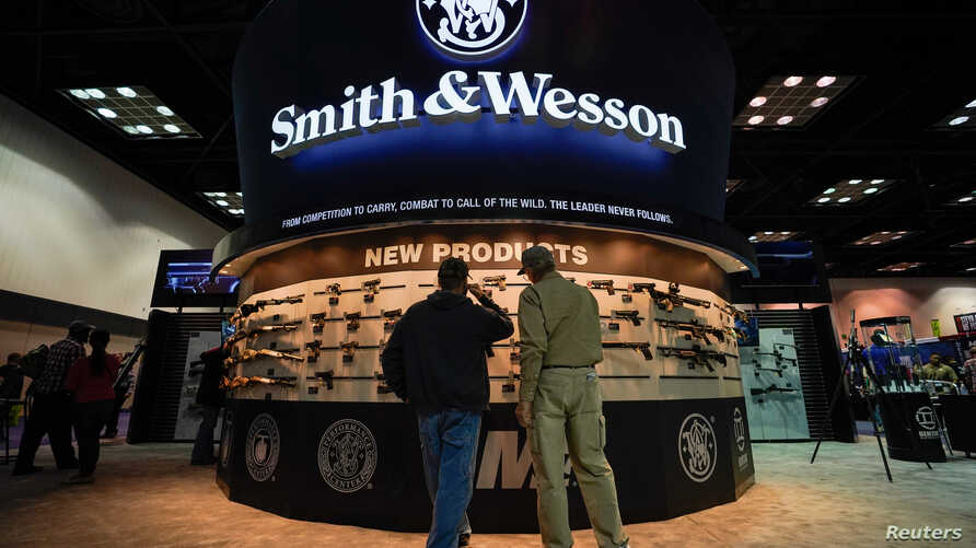 Attendee inspect Smith and Wesson firearms at the National Rifle Association's (NRA) annual meeting, in Indianapolis, Indiana,…